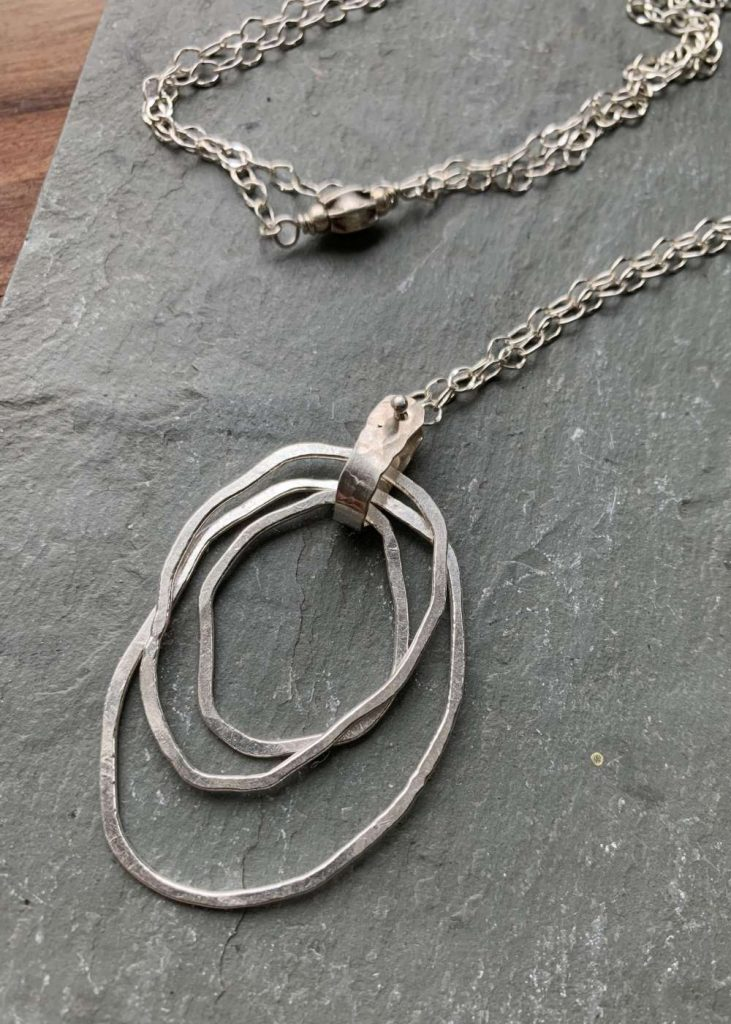 long silver circles necklace