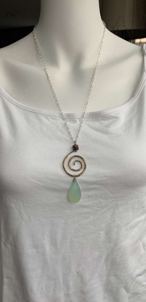 metal swirl and gemstone necklace